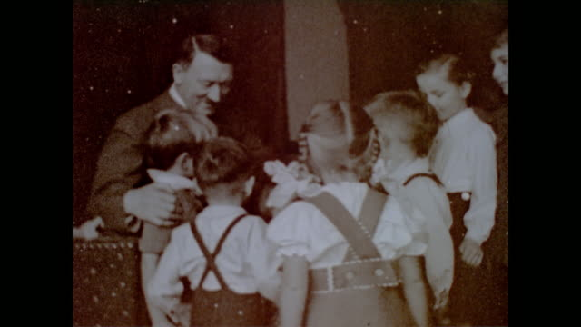 vídeos de stock, filmes e b-roll de young boy in nazi uniform / note: from eva braun's home movie collection - adolf hitler