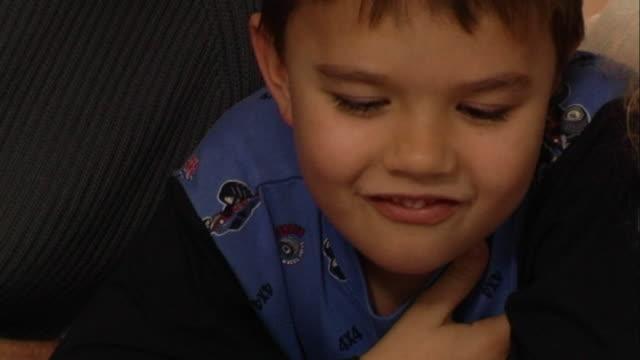 vídeos de stock, filmes e b-roll de young boy in pyjamas - equipamento doméstico