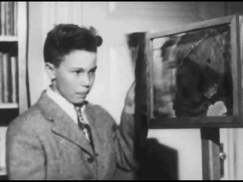 / young boy in suit and tie emphatically presents a drawing / reverse shot of crowd of children sitting at tables listening / panning shot of... - 1951 stock videos and b-roll footage