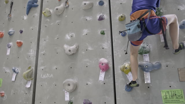 young boy is climbing an indoor climbing wall - climbing rope stock videos & royalty-free footage