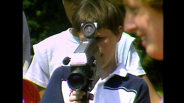 young boy learns to use video camera; 1984 - less than 10 seconds stock videos & royalty-free footage