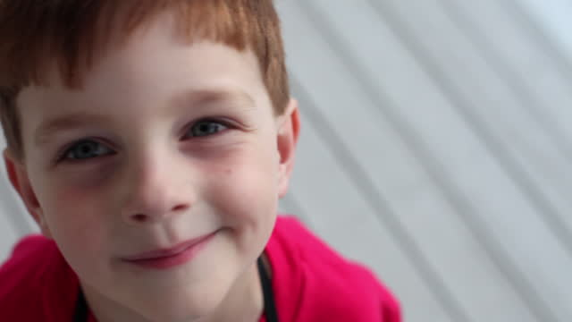 a young boy looks sad, then looks happy. - mischief stock videos & royalty-free footage