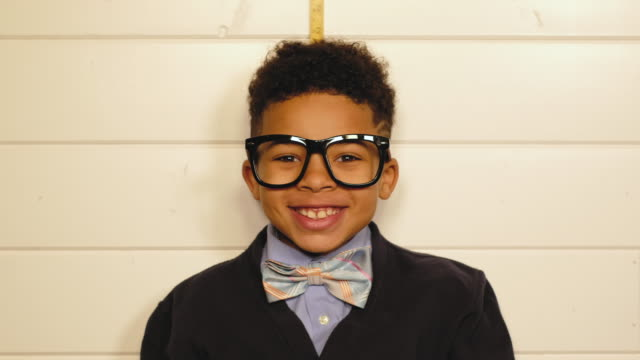 young boy nerd measures his height - instrument of measurement stock videos & royalty-free footage