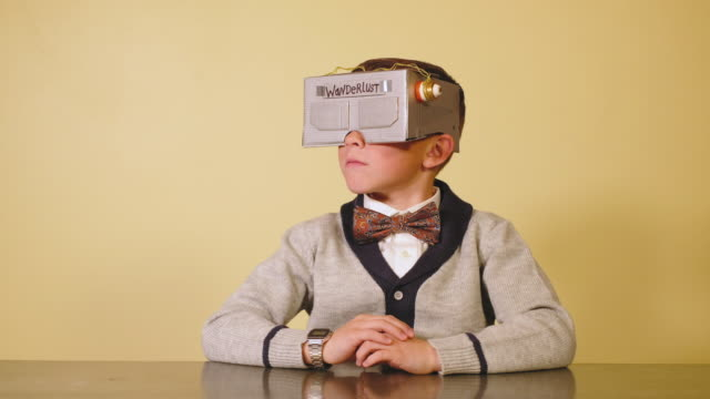 young boy nerd with homemade virtual reality headset - geek stock videos & royalty-free footage