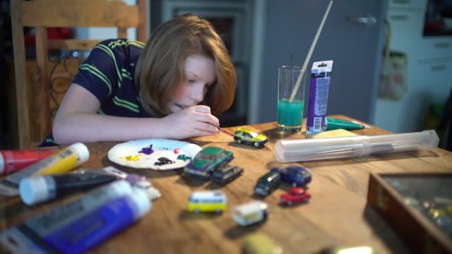 a young boy painting his cars - collection stock videos and b-roll footage