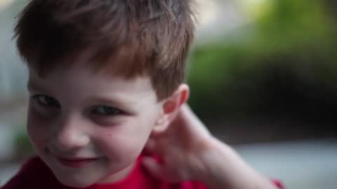 vídeos y material grabado en eventos de stock de a young boy playfully dances for the camera. - mischief