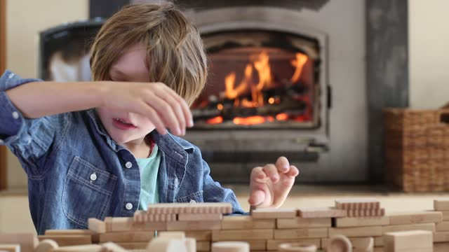young boy playin with blocks - nur jungen stock-videos und b-roll-filmmaterial
