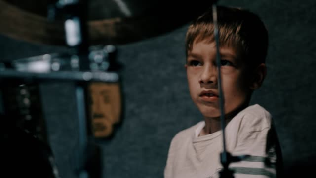 young boy playing drums, front view - drum percussion instrument stock videos & royalty-free footage