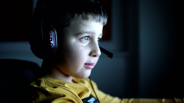 young boy playing games on a computer at home - leisure games stock videos & royalty-free footage