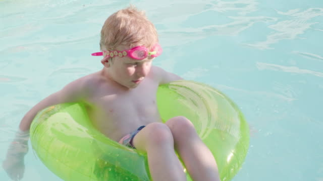 young boy playing in the swimming pool - swimming goggles stock videos & royalty-free footage