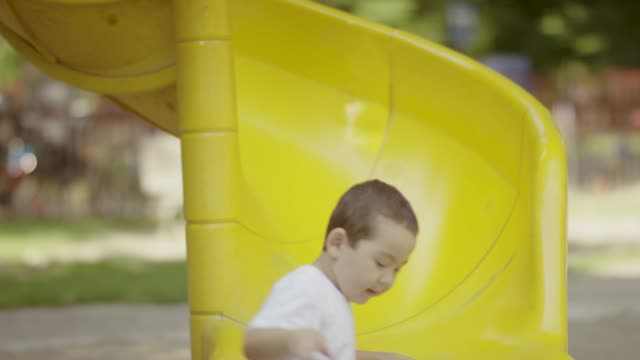 Young boy playing on jungle gym