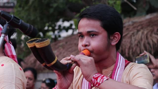 "young boy playing ""pepa"" during assamese traditional bihu dance at an event ahead of rongali bihu ot bohag bihu festival on april 12, 2021 in... - teenage girls stock videos & royalty-free footage"