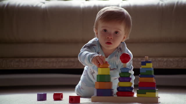 ms young boy playing with blocks in living room / minnesota, usa  - toy block stock videos and b-roll footage