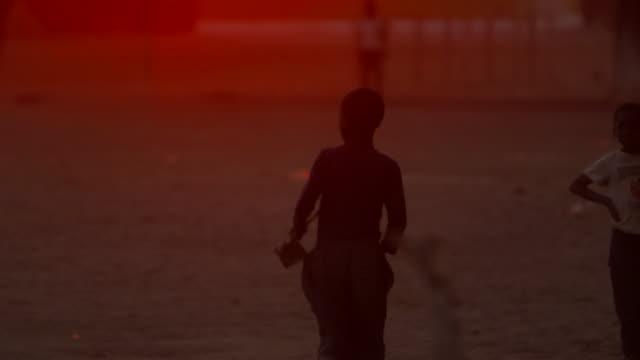 Young boy plays at sunset Angola