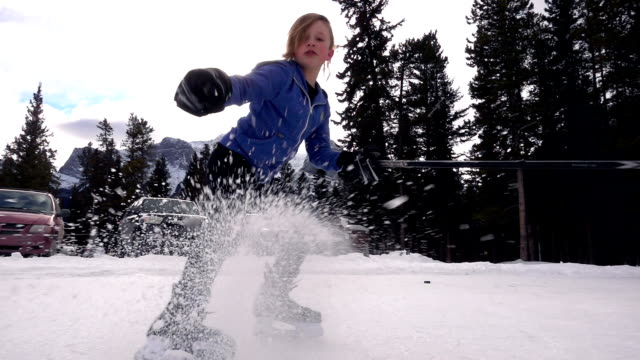 young boy plays ice hockey, at mountain pond - hockey glove stock videos & royalty-free footage