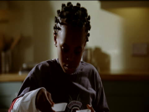 young boy preparing a baking tray in a kitchen - baking tray stock videos & royalty-free footage