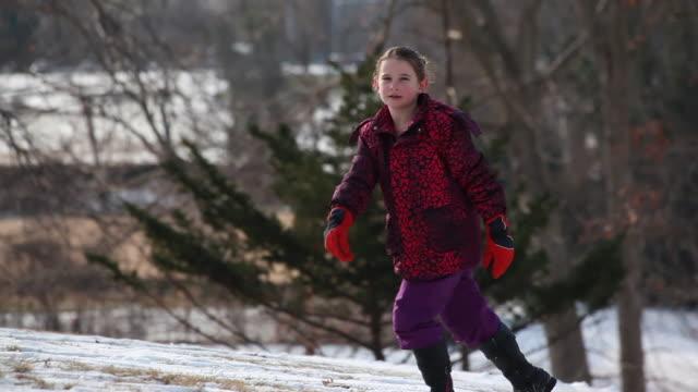 young boy pulling a sled and young girl following behind run/ walk up a toboggan hill. - kelly mason videos stock videos & royalty-free footage