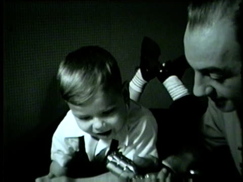vidéos et rushes de a young boy reads the chicago daily tribune to a wgn reporter in 1953 - 1953