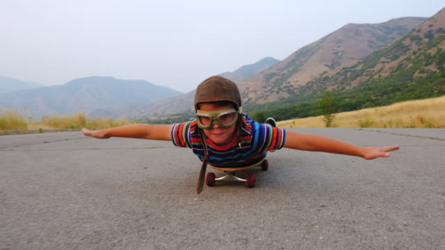 young boy riding on a skateboard - elementary age stock videos & royalty-free footage