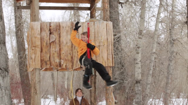 ms pan young boy riding on zip-line / sun valley, idaho, united states - zip line stock videos & royalty-free footage