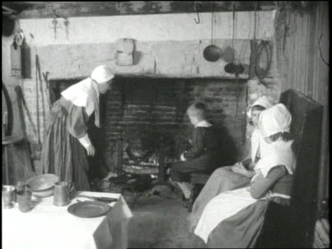 a young boy rotates a turkey over a fire in preparation for the first thanksgiving feast in 1621 - meal preparation stock videos & royalty-free footage