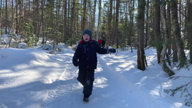 young boy running in the forest in winter after snowstorm - leisure activity stock videos & royalty-free footage
