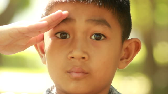 young boy salute - saluting stock videos & royalty-free footage