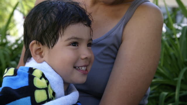 young boy sits in mother's lap - wrapped in a towel stock videos & royalty-free footage