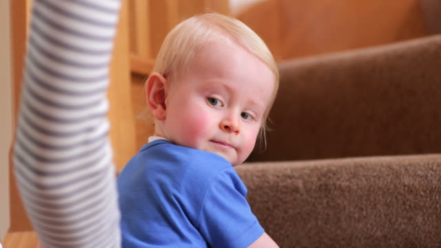 young boy slowly crawling up the stairs - balance stock videos & royalty-free footage