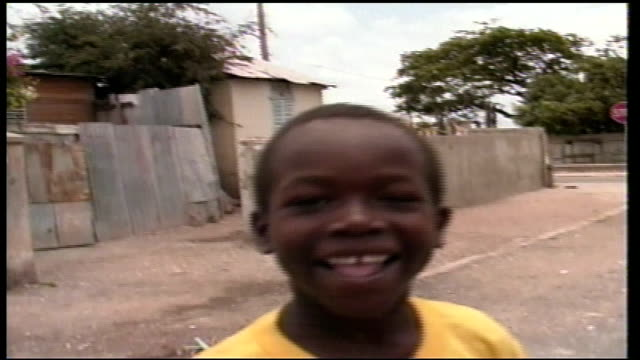 Young Boy Smilling at Camera in Jamaica