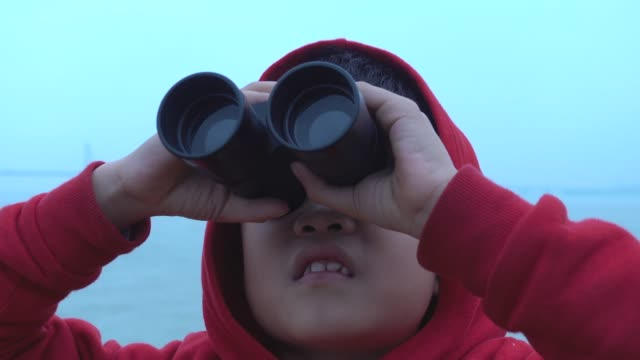 young boy surprised in looking with binoculars on tourboat - binoculars stock videos & royalty-free footage