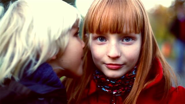 young boy telling secret to a girl - whispering stock videos & royalty-free footage