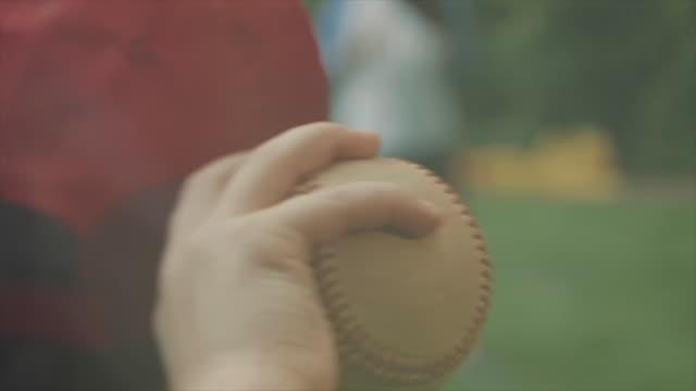 A young boy throwing a baseball