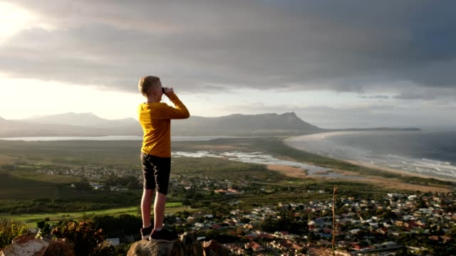 young boy uses binoculars to look at the view - binoculars stock videos & royalty-free footage
