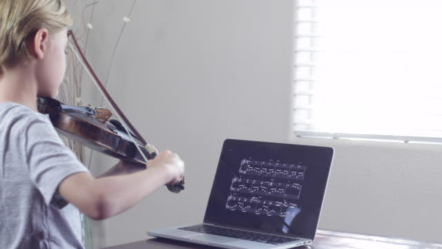 a young boy using a laptop - violin stock videos & royalty-free footage