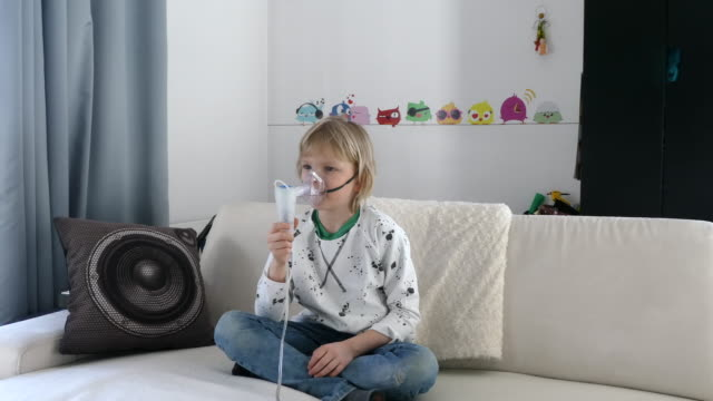 young boy using asthma inhaler. - recovery stock videos & royalty-free footage