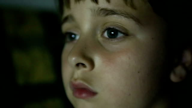 young boy watching tv - spectator stock videos & royalty-free footage