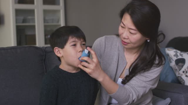 a young boy with asthma - allergy stock videos & royalty-free footage