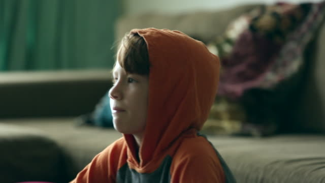 cu young boy with hoodie, profile - living room stock videos & royalty-free footage