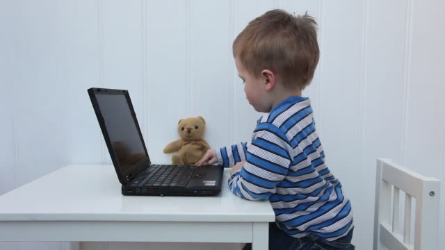 young boy with laptop - preschool age stock videos & royalty-free footage