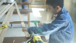 Young boy working as carpenter