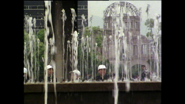 young boys admire fountain in hiroshima peace park; 1975 - nuclear bomb stock videos & royalty-free footage