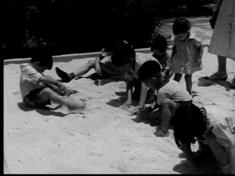 stockvideo's en b-roll-footage met 1935 ms young boys and girls playing in sandbox/ jacksonville, florida - 1935
