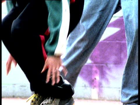 Young boys feet and legs break dancing