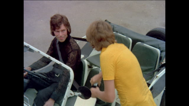 vidéos et rushes de montage young boys getting ready to compete in bicycle competition / united kingdom - 1971