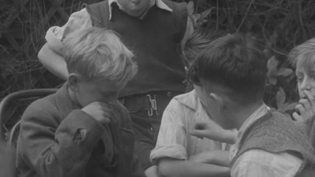 1947 ms young boys playing board game at a table / united kingdom - brettspiel stock-videos und b-roll-filmmaterial