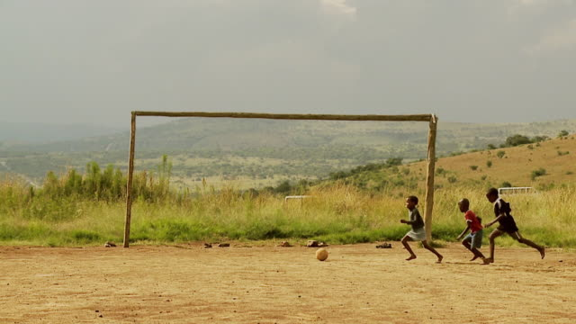 Young boys playing football in South Africa.