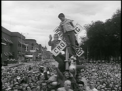 b/w 1952 young boys stand on railroad crossing sign above crowd / eisenhower campaign / newsreel - anno 1952 video stock e b–roll