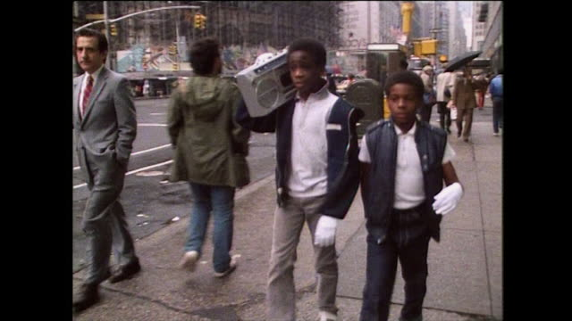 young boys strut down the street with boom box; 1976 - t shirt stock videos & royalty-free footage