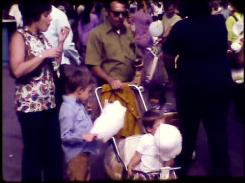 / young boys with their mother and father eat cotton candy at the zoo / toddler in stroller young boys eating cotton candy on january 01 1973 - home movie stock videos & royalty-free footage